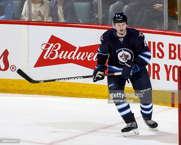 Jacob Trouba of the Winnipeg Jets follows the play up the ice during third period action against the Minnesota Wild at the MTS Centre on April 3 2016...