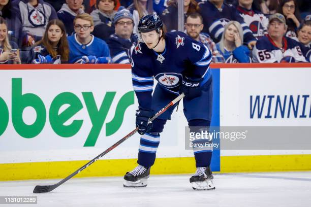 Jacob Trouba of the Winnipeg Jets gets set during a second period faceoff against the Ottawa Senators at the Bell MTS Place on February 16 2019 in...