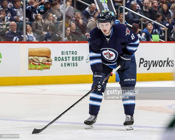 Jacob Trouba of the Winnipeg Jets gets set for a second period faceoff against the Minnesota Wild at the MTS Centre on April 3 2016 in Winnipeg...