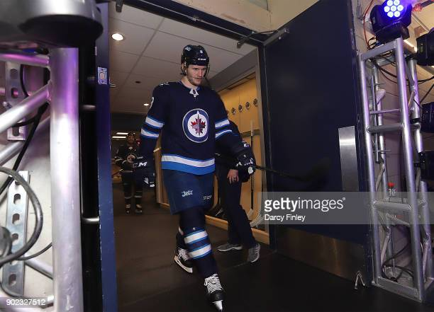 Jacob Trouba of the Winnipeg Jets gets set to hit the ice prior to puck drop against the San Jose Sharks at the Bell MTS Place on January 7 2018 in...
