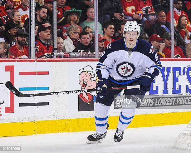 Jacob Trouba of the Winnipeg Jets in action against the Calgary Flames during an NHL game at Scotiabank Saddledome on March 16 2016 in Calgary...