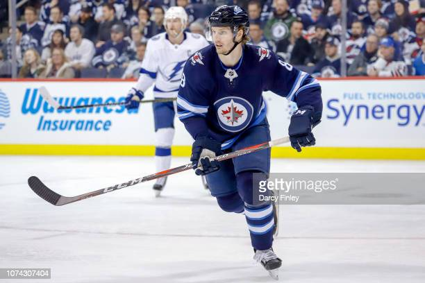 Jacob Trouba of the Winnipeg Jets keeps an eye on the play during third period action against the Tampa Bay Lightning at the Bell MTS Place on...