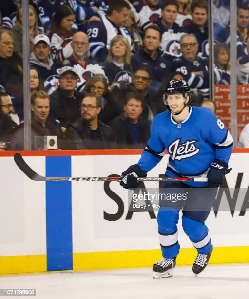 Jacob Trouba of the Winnipeg Jets keeps an eye on the play during second period action against the Pittsburgh Penguins at the Bell MTS Place on...