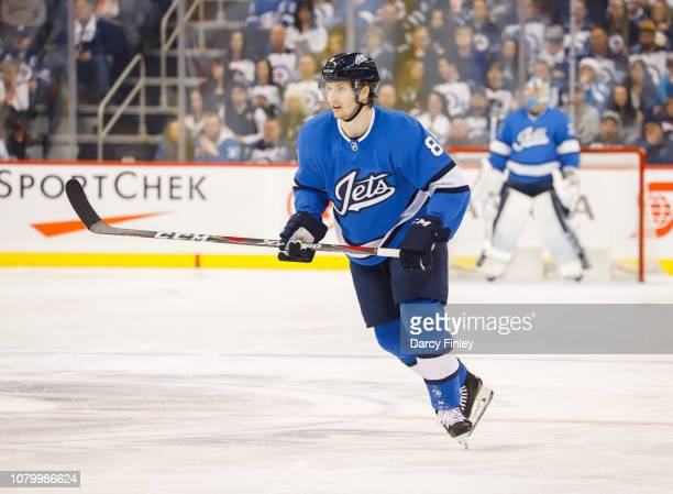 Jacob Trouba of the Winnipeg Jets keeps an eye on the play during second period action against the St Louis Blues at the Bell MTS Place on December 7...