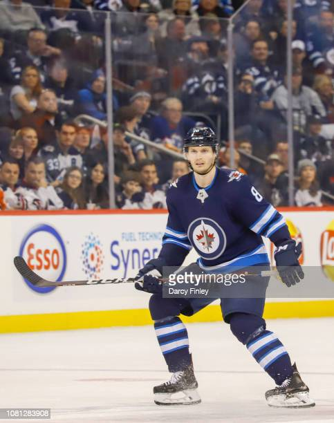 Jacob Trouba of the Winnipeg Jets keeps an eye on the play during second period action against the Philadelphia Flyers at the Bell MTS Place on...