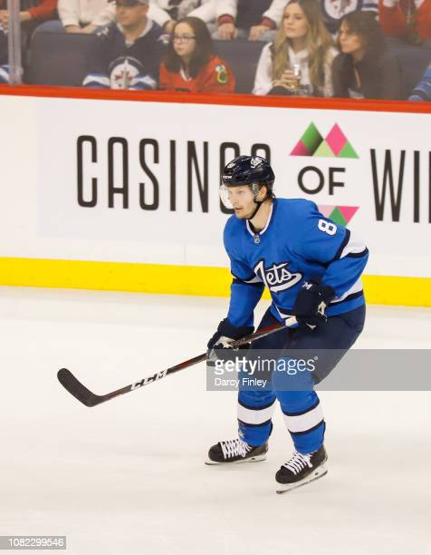 Jacob Trouba of the Winnipeg Jets keeps an eye on the play during second period action against the Chicago Blackhawks at the Bell MTS Place on...
