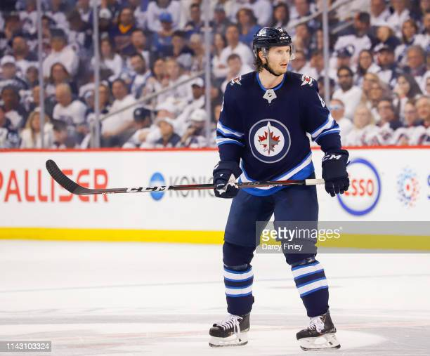 Jacob Trouba of the Winnipeg Jets keeps an eye on the play during first period action against the St Louis Blues in Game Two of the Western...