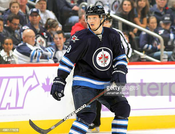 Jacob Trouba of the Winnipeg Jets keeps an eye on the play during second period action against the Philadelphia Flyers at the MTS Centre on November...