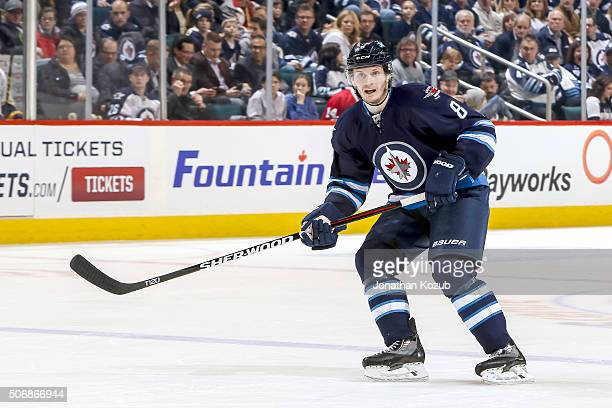 Jacob Trouba of the Winnipeg Jets keeps an eye on the play during second period action against the Nashville Predators at the MTS Centre on January...