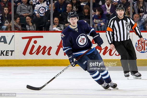 Jacob Trouba of the Winnipeg Jets keeps an eye on the play during second period action against the Los Angeles Kings at the MTS Centre on March 24...
