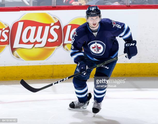 Jacob Trouba of the Winnipeg Jets keeps an eye on the play during third period action against the Chicago Blackhawks at the MTS Centre on February 10...