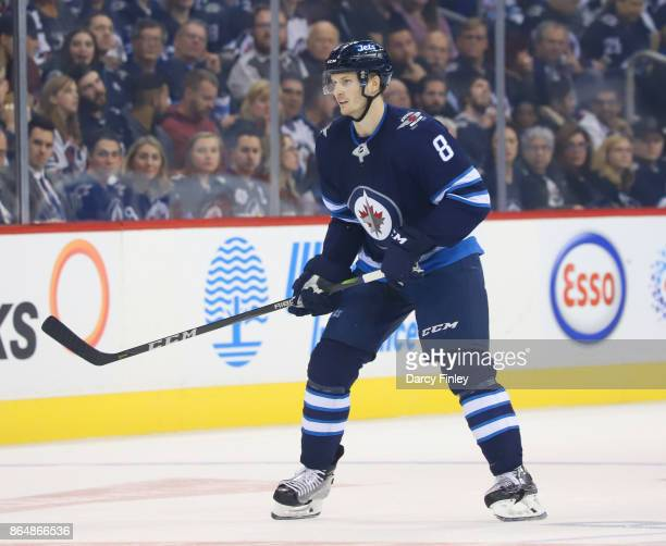 Jacob Trouba of the Winnipeg Jets keeps an eye on the play during first period action against the Columbus Blue Jackets at the Bell MTS Place on...