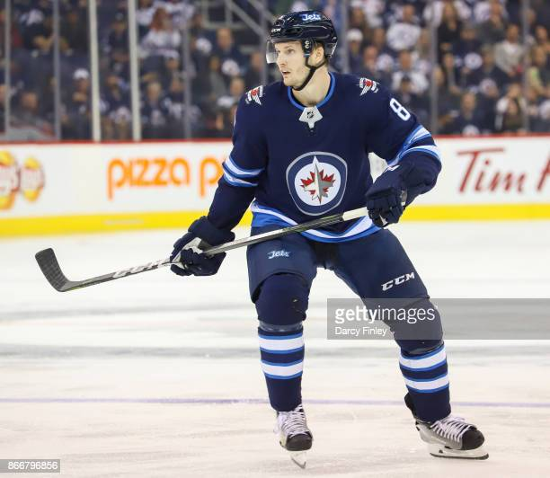 Jacob Trouba of the Winnipeg Jets keeps an eye on the play during second period action against the Minnesota Wild at the Bell MTS Place on October 20...