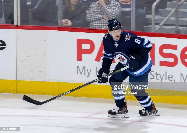 Jacob Trouba of the Winnipeg Jets keeps an eye on the play during third period action against the New York Islanders at the Bell MTS Place on...
