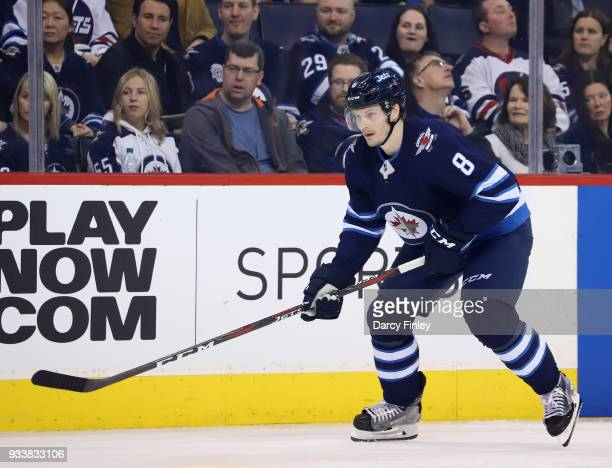 Jacob Trouba of the Winnipeg Jets keeps an eye on the play during second period action against the Dallas Stars at the Bell MTS Place on March 18...