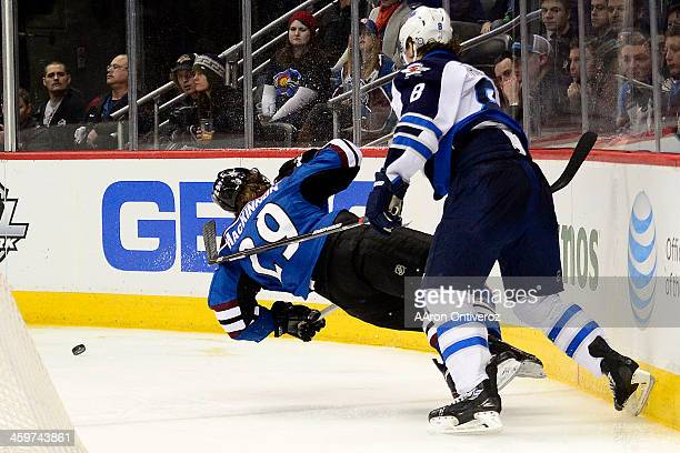 Jacob Trouba of the Winnipeg Jets lays out Nathan MacKinnon of the Colorado Avalanche during the third period of action The Colorado Avalanche lost...