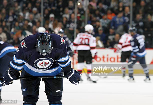 Jacob Trouba of the Winnipeg Jets leans over dejectedly following a 31 loss to the New Jersey Devils at the MTS Centre on January 23 2016 in Winnipeg...