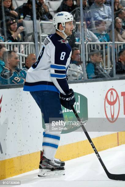 Jacob Trouba of the Winnipeg Jets look on during a NHL game against the San Jose Sharks at SAP Center on January 23 2018 in San Jose California