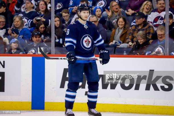 Jacob Trouba of the Winnipeg Jets looks on during a first period stoppage in play against the Ottawa Senators at the Bell MTS Place on February 16...