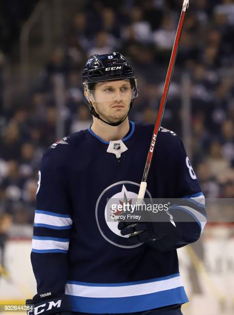 Jacob Trouba of the Winnipeg Jets looks on during a third period stoppage in play against the Chicago Blackhawks at the Bell MTS Place on March 15...