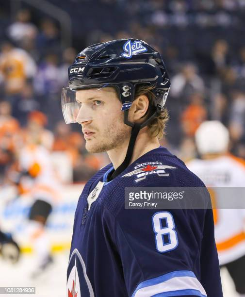 Jacob Trouba of the Winnipeg Jets looks on during the pregame warm up prior to NHL action against the Philadelphia Flyers at the Bell MTS Place on...