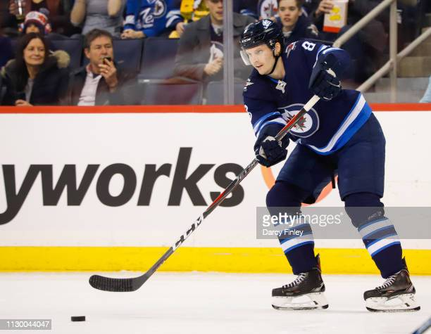 Jacob Trouba of the Winnipeg Jets passes the puck up the ice during first period action against the New York Rangers at the Bell MTS Place on...