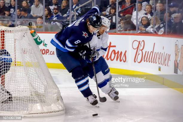 Jacob Trouba of the Winnipeg Jets plays the puck around the net away from Tyler Johnson of the Tampa Bay Lightning during third period action at the...