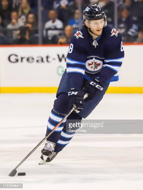 Jacob Trouba of the Winnipeg Jets plays the puck down the ice during first period action against the Columbus Blue Jackets at the Bell MTS Place on...