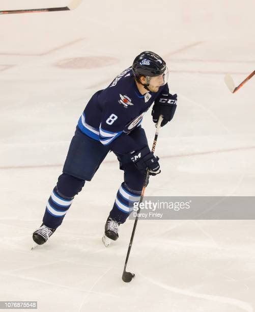 Jacob Trouba of the Winnipeg Jets plays the puck up the ice during second period action against the Chicago Blackhawks at the Bell MTS Place on...