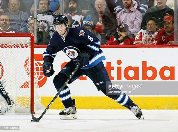 Jacob Trouba of the Winnipeg Jets plays the puck up the ice during second period action against the Detroit Red Wings at the MTS Centre on December 6...
