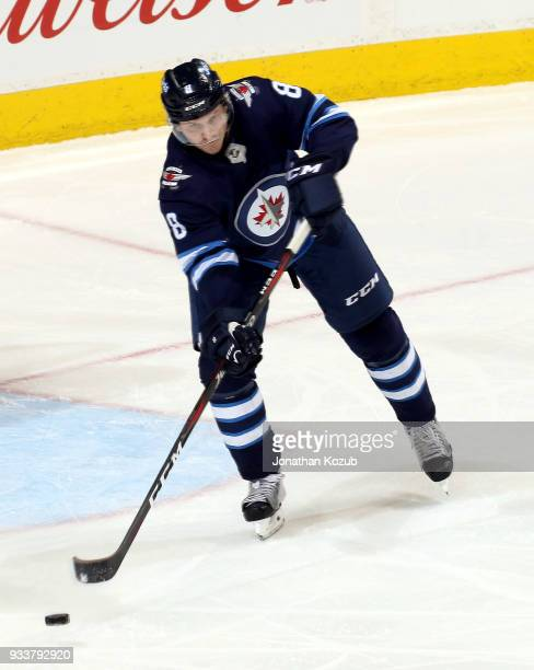 Jacob Trouba of the Winnipeg Jets plays the puck up the ice during second period action against the Dallas Stars at the Bell MTS Place on March 18...