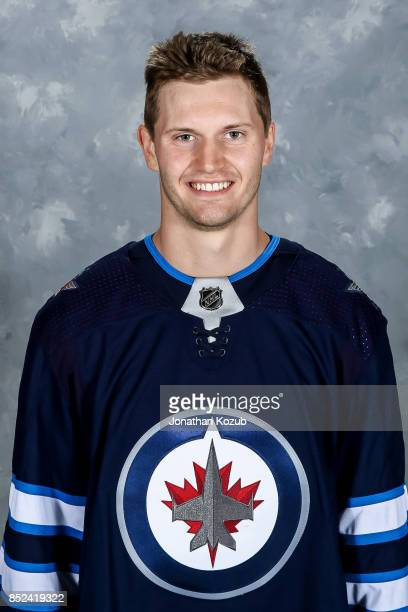 Jacob Trouba of the Winnipeg Jets poses for his official headshot for the 20172018 season on September 14 2017 at the Bell MTS Iceplex in Winnipeg...