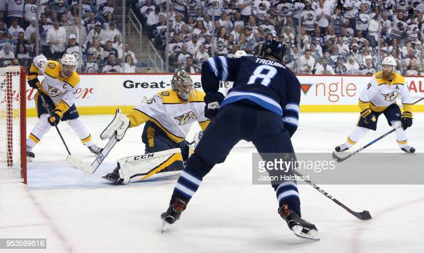 Jacob Trouba of the Winnipeg Jets shoots against Pekka Rinne of the Nashville Predators in Game Three of the Western Conference Second Round during...