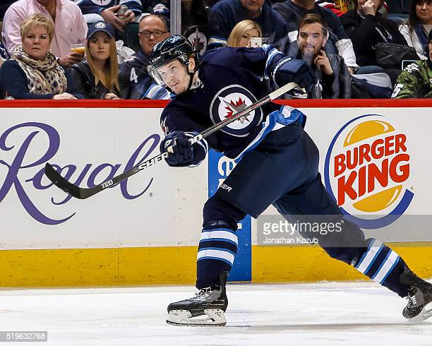 Jacob Trouba of the Winnipeg Jets shoots the puck down the ice during second period action against the Chicago Blackhawks at the MTS Centre on April...