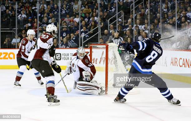 Jacob Trouba of the Winnipeg Jets shoots the puck past goaltender Jeremy Smith of the Colorado Avalanche for a third period goal at the MTS Centre on...