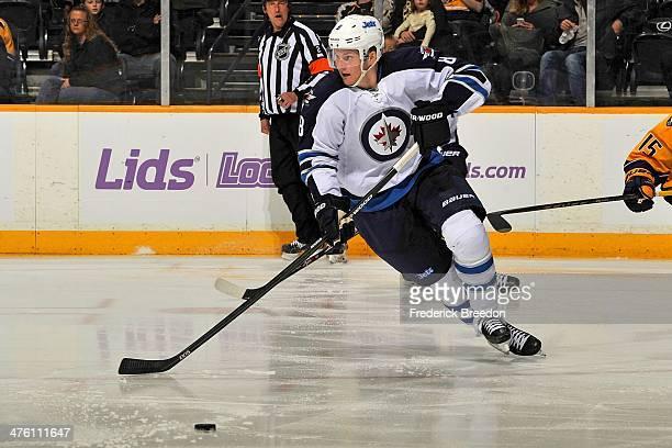 Jacob Trouba of the Winnipeg Jets skates against the Nashville Predators at Bridgestone Arena on March 1 2014 in Nashville Tennessee