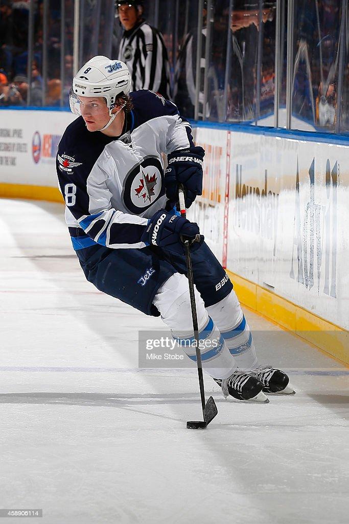 Jacob Trouba #8 of the Winnipeg Jets skates against the New York Islanders at Nassau Veterans Memorial Coliseum on October 28, 2014 in Uniondale, New York. The Winnipeg Jets defeated the New York Islanders 4-3.