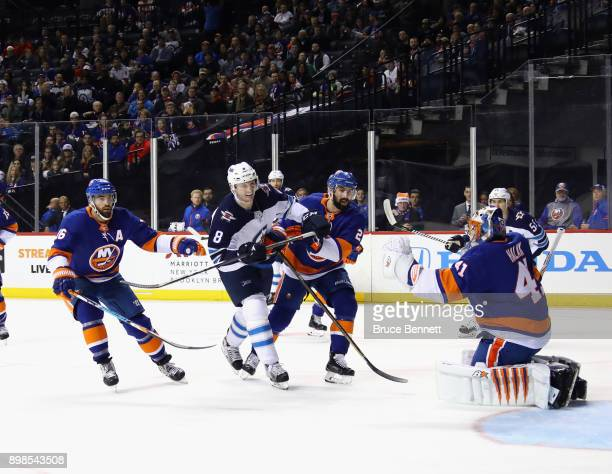 Jacob Trouba of the Winnipeg Jets skates against the New York Islanders at the Barclays Center on December 23 2017 in the Brooklyn borough of New...