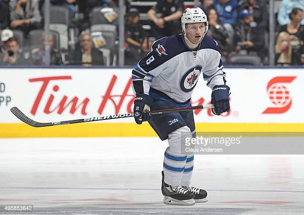 Jacob Trouba of the Winnipeg Jets skates against the Toronto Maple Leafs during an NHL game at the Air Canada Centre on November 4 2015 in Toronto...