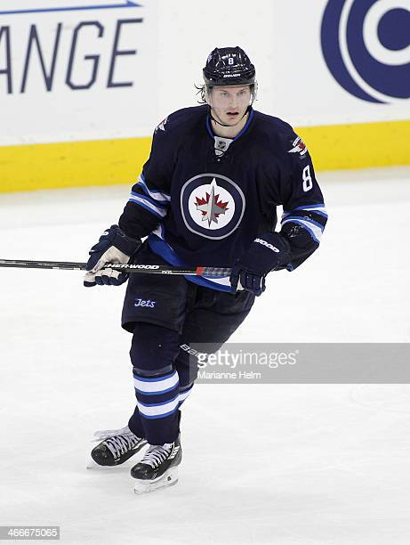 Jacob Trouba of the Winnipeg Jets skates on the ice during third period action in an NHL game against the Columbus Blue Jackets at the MTS Centre on...