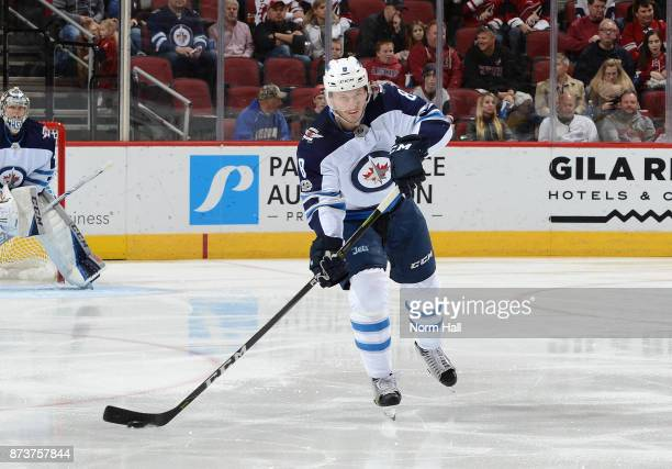 Jacob Trouba of the Winnipeg Jets skates with the puck against the Arizona Coyotes at Gila River Arena on November 11 2017 in Glendale Arizona