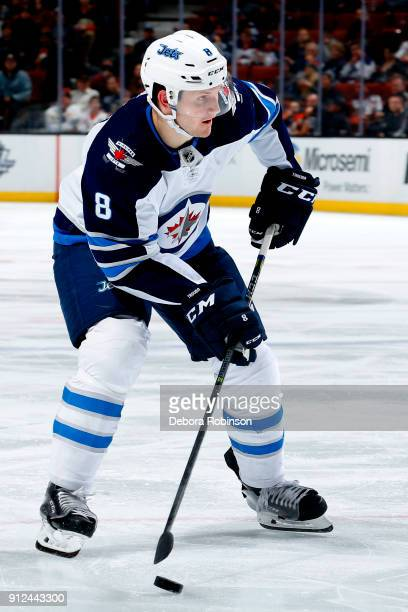 Jacob Trouba of the Winnipeg Jets skates with the puck during the game against the Anaheim Ducks on January 25 2018 at Honda Center in Anaheim...