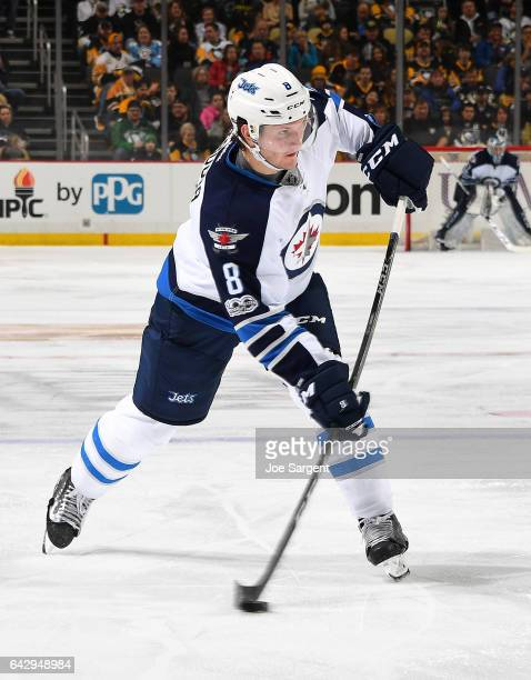 Jacob Trouba of the Winnipeg Jets takes a shot during the game against the Pittsburgh Penguins at PPG Paints Arena on February 16 2017 in Pittsburgh...