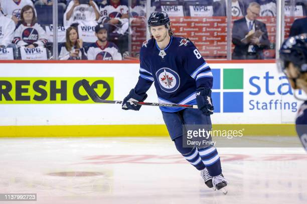 Jacob Trouba of the Winnipeg Jets takes part in the pregame warm up prior to NHL action against the St Louis Blues in Game Five of the Western...