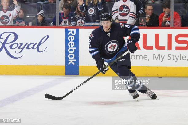 Jacob Trouba of the Winnipeg Jets takes part in the pregame warm up prior to NHL action against the Tampa Bay Lightning at the MTS Centre on February...