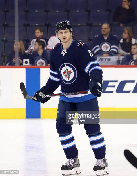 Jacob Trouba of the Winnipeg Jets takes part in the pregame warm up prior to NHL action against the Chicago Blackhawks at the Bell MTS Place on March...