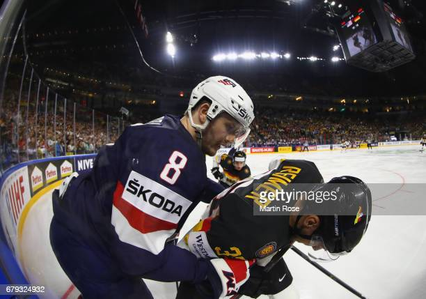 Jacob Trouba of USA challenges Patrick Reimer of Germany during the 2017 IIHF Ice Hockey World Championship game between USA and Germany at Lanxess...