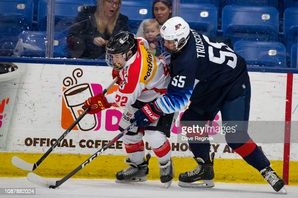 Jacob Truscott of the US Nationals battles for the puck with Mike Zaugg of the Switzerland Nationals during day2 of game two of the 2018 Under17 Four...