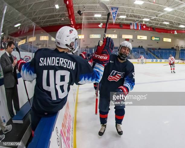 Jacob Truscott of the US Nationals celebrates a second period goal against the Switzerland Nationals with teammate Jake Sanderson during day2 of game...