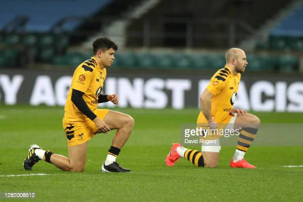 Jacob Umaga and Dan Robson of Wasps take a knee in support of the Black Lives Matter Movement prior to during the Gallagher Premiership Rugby final...